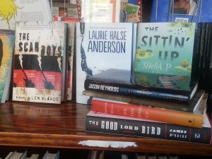 Selection of books, including teen/young adult, at Busboys & Poets